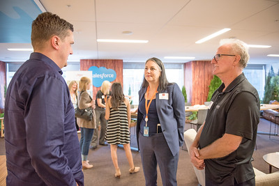 Evelyn Buchanan (center) enjoys a conversation at Chico State's Alumni Day at Salesforce West on Thursday, May 10, 2018 in San Francisco, Calif. (Jessica Bartlett /University Photographer/CSU Chico)