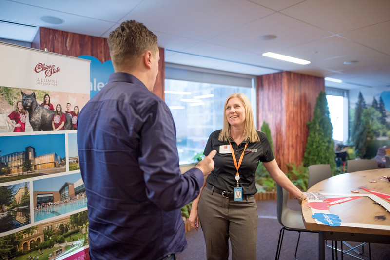 Megan Odom (right) enjoys a conversation with an alumni at Chico State's Alumni Day at Salesforce West on Thursday, May 10, 2018 in San Francisco, Calif. (Jessica Bartlett /University Photographer/CSU Chico)