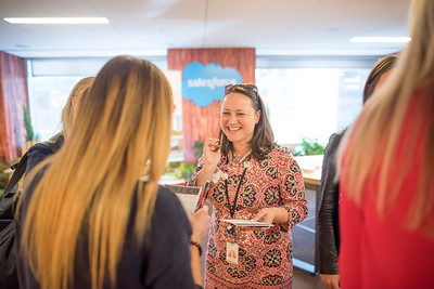 Alumnus Penelope Thompson (center) enjoys a conversation at Chico State's Alumni Day at Salesforce West on Thursday, May 10, 2018 in San Francisco, Calif. (Jessica Bartlett /University Photographer/CSU Chico)