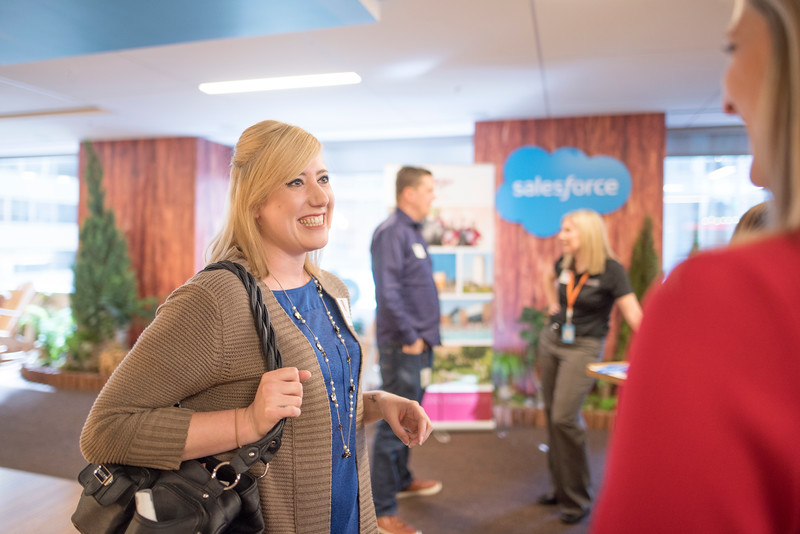 Megan Murphy (left) enjoys a conversation with fellow alumni at Chico State's Alumni Day at Salesforce West on Thursday, May 10, 2018 in San Francisco, Calif. (Jessica Bartlett /University Photographer/CSU Chico)