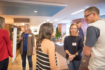 Kato Hines (center) enjoys a conversation with fellow alumni at Chico State's Alumni Day at Salesforce West on Thursday, May 10, 2018 in San Francisco, Calif. (Jessica Bartlett /University Photographer/CSU Chico)