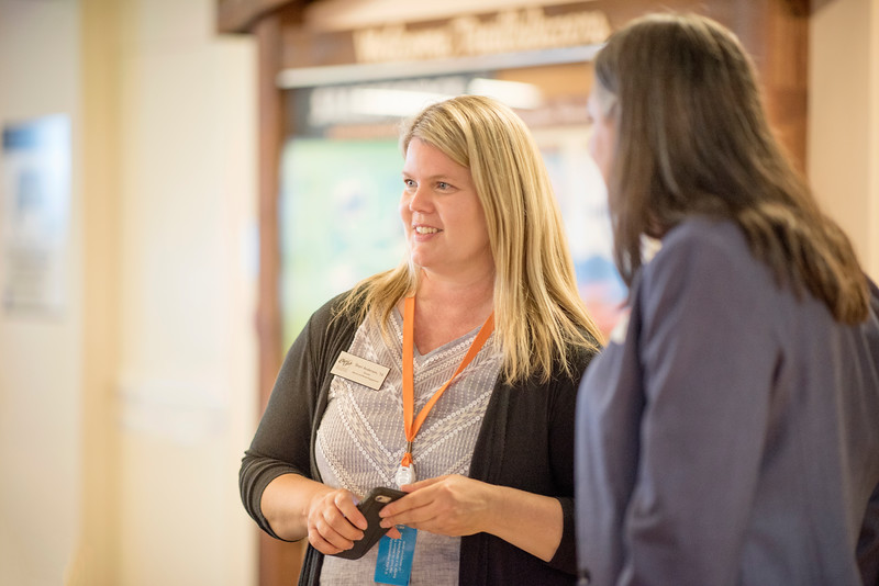 Shari Anderson (left) enjoys a conversation at Chico State's Alumni Day at Salesforce West on Thursday, May 10, 2018 in San Francisco, Calif. (Jessica Bartlett /University Photographer/CSU Chico)
