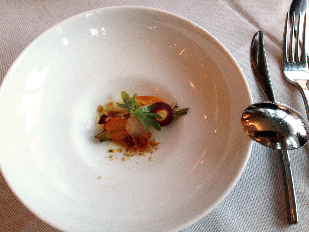 Amuse Bouche: Kohlrabi and Carrot with Pistachio drizzled in Vinaigrette