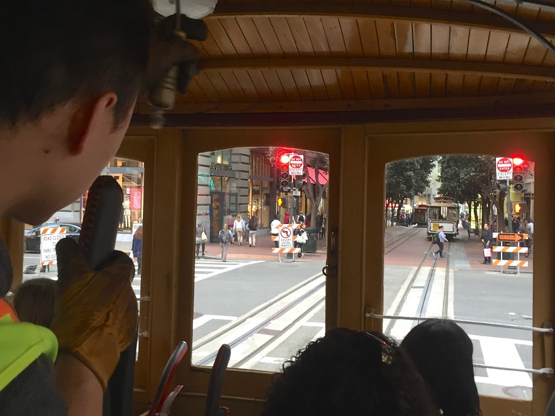 This is the view of the cable car operator has. You must be operating both a break and something that grabs the cable.