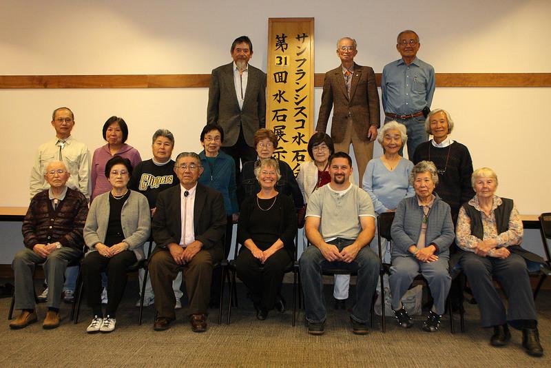 Happy SF Suiseki Kai members at the end of the 31st annual show.<br /> <br /> Front row from left: Mr. Shojirou Iwasaki, Mrs. Eiko Iwasaki, Mr. Ben Nanjo, Ms. Janet Roth, Mr. William B. Meran, Mrs. A Yin Chung, Ms. Barbara Wilson<br /> <br /> MIddle row from left: Mr. Wen Pai Chen, Mrs. Hsu Huei (Sue) Chen, Mrs. Yaeko Nishizawa, Mrs. Mieko Yoshikawa, Mrs. MIyako Kazama, Mrs. Motoko Nanjo, Mrs. Hideko Metaxas, Mr. Mas Nakajima<br /> <br /> Back row from left: Mr. John Nishizawa, Mr. Ben Yoshikawa, Mr. Yoneo (John) Uchida