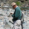 Ben Yoshikawa examining a stone