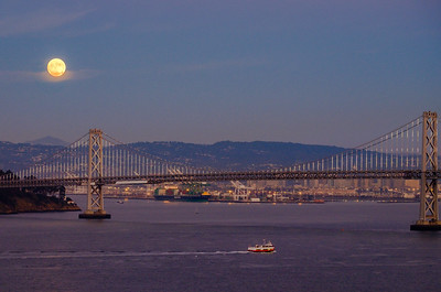 Super moon rising over San Francisco  Bay Bridge