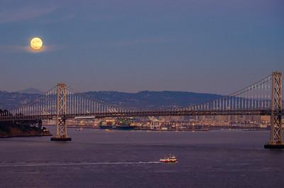 Super moon rising over San Francisco  Bay Bridge