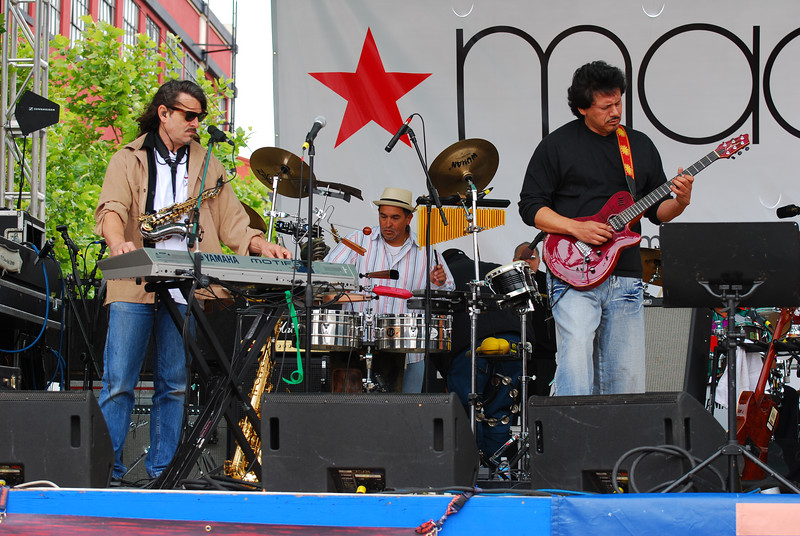 "La Ventana's Blaine Hoopes (sax & keyboards), Mio ""Timbalero"" Flores on (timbales & latin percussion), Johnny De La Cruz (guitar).  Hidden behind Johnny, Eric Engstrom (drums)."