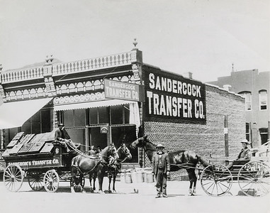William Sandercock in front of Sandercock Transfer Company building, 1880-1889. #01.01.3654.