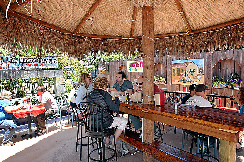 . A large Palapa covers the outdoor dining patio at San Marcos Charquito in Capitola.  (Dan  Coyro -- Santa Cruz Sentinel)