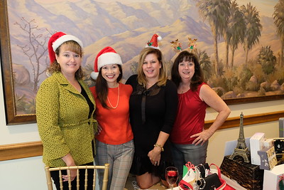 L.A. County USC Holiday Shop-a-thon committee members Justine Pierce and Cindy Metcalfe with chairs Pamela Rasmussen and Jacky Samartin