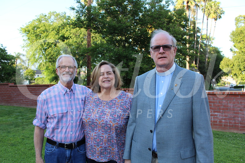 Ron and Michelle Harrington with Father Bill Doggett