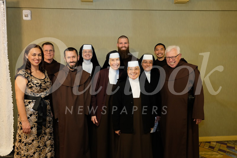 Principal Alma Cornejo with members of the Order of the Carmelite Discalced, including Father Donald, Brother John, Sister Isabelle, Sister Mary Karen, Honoree Father Matthias, Sister Meredith, Sister Julianne, Brother Dustin and Father Albert