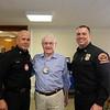 Fire Chief Mario Rueda, Cal Taylor and Division Chief Mark Dondanville