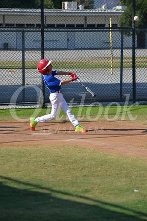 DSC_ Nathan Sanok of San Marino gets a base hit 0014