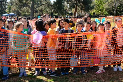 4 Kids await the opening of the gate to the field filled with Easter Eggs