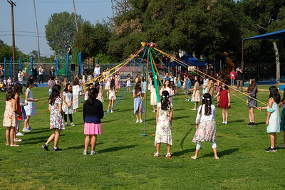 12 The Fifth Grade girls perform the traditional May Pole dance