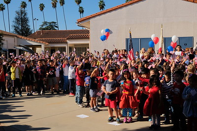 26 Students enjoyed waving their flags as they sing
