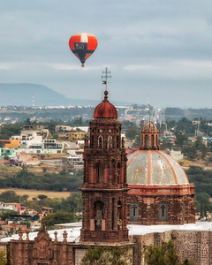 Balloon ascending over San Miguel de Allende