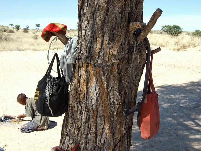 San Bushman Artist Creating Bone Artwork in the Kalahari