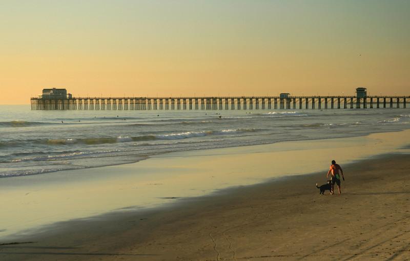 San Diego Beaches, Man and Dog on Oceanside Beach