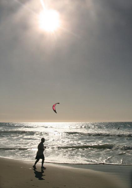 Jogger & Kite Surfer, Carlsbad Beach with Winter Sun