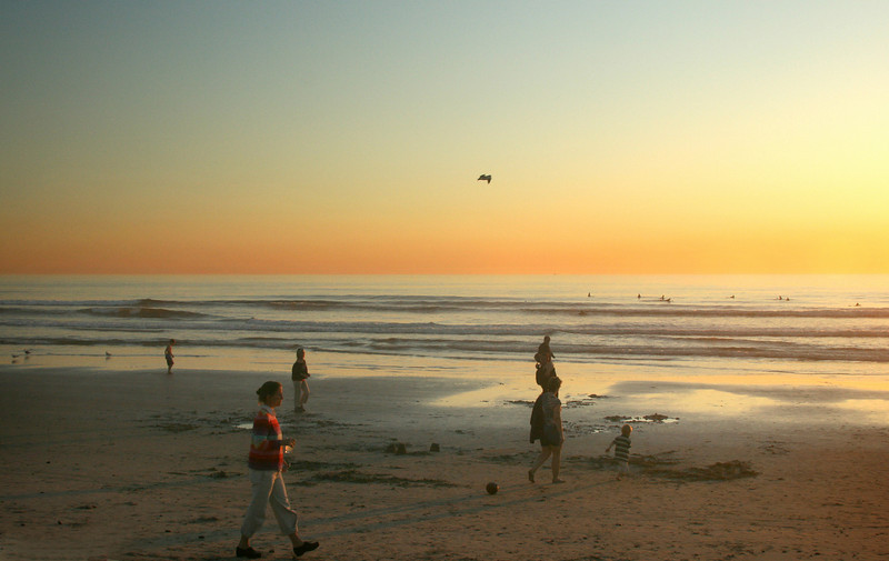 San Diego Beaches, Walkers and Surfers at Carlsbad Beach