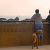 Carlsbad California, Couple with Dog Enjoying Sunset Over Ocean