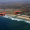 Carlsbad Bi-Planes Flying Over Coast