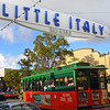 Little Italy San Diego, Trolley under Little Italy Sign © Joanne DiBona