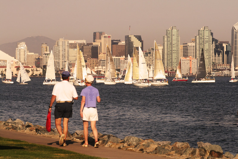 San Diego Skylines, Couple Walking Along Harbor Drive with View on Skyline
