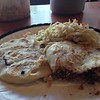 Pupusa, the traditional Salvadoran dish, made from pure nixtamalized corn flour (white corn flour) with cabbage and filled with black beans or chicken or beef. Gluten-free and no dairy, though the American version has usually cheese added. There are some small good restaurants in the Mission district offering it.