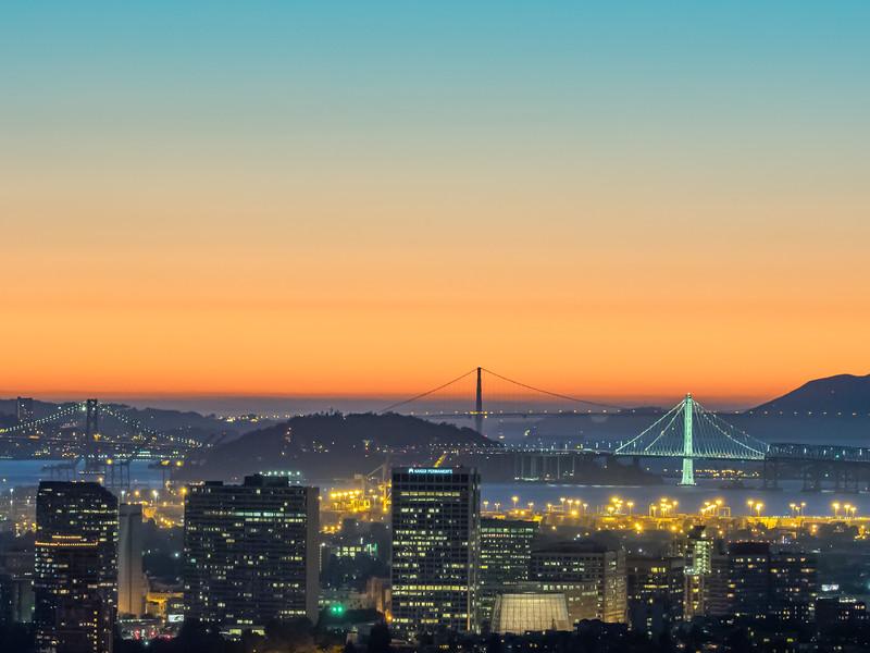 Downtown Oakland, Bay Bridge, and Golden Gate Bridge after Sunset, Oakland CA
