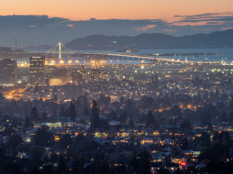 Oakland at Dusk with Bay Bridge in the Background