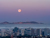 Full Moon Setting over SF and Downtown Oakland