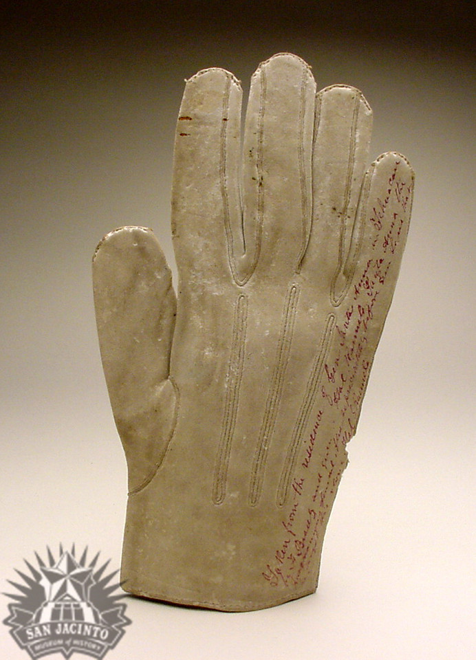 "Single white kid glove for the right hand, with brass button at wrist.  Hand written on face ""Santa Anna.""  Hand written on back ""Taken from the residence of General Santa Anna in Tehuacan by F. Brantz, and given to Hal Runnels."""