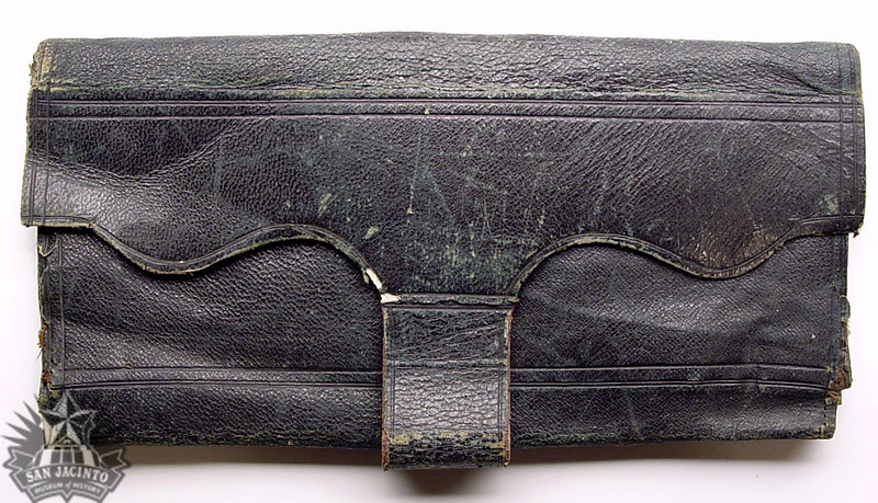 Dark green leather wallet owned by Alexander Horton.