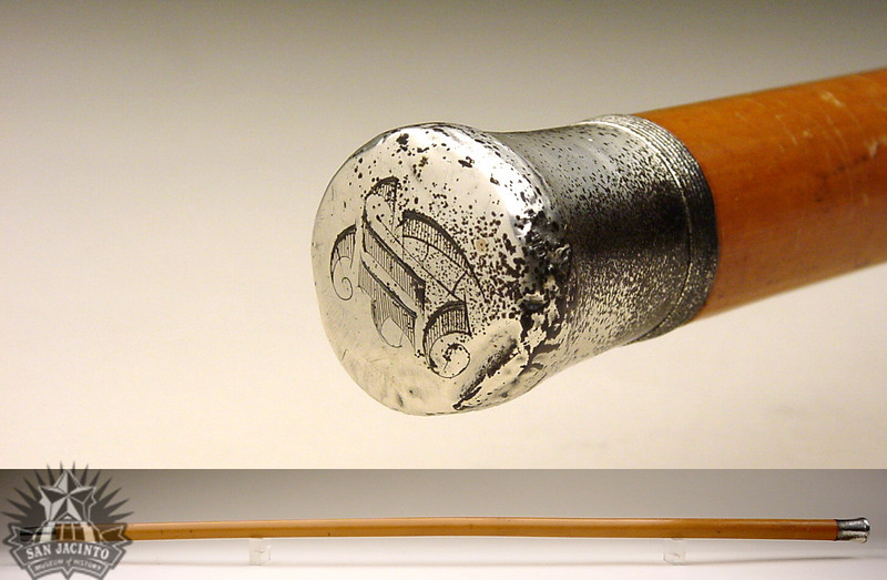Walking stick made of highly lacquered apple wood with a silver cap and tip, carried by Sam Houston during the time of the Mexican-American War.
