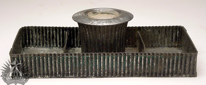 Inkstand made of corrugated tin with traces of iridescent blue-green paint, owned by San Jacinto veteran Alexander Horton.