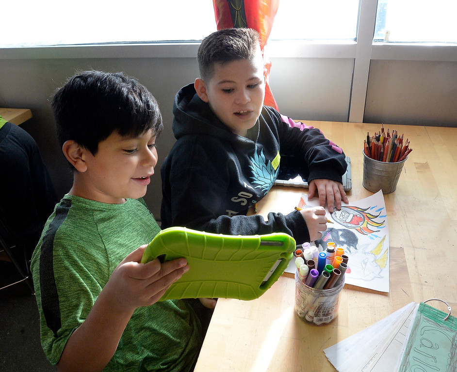 . LAFAYETTE, CO - January 31, 2019: Carlos Alas Santos, left, and Aaron Salazar, are fifth-graders in art class.  Alicia Sanchez Elementary School in Lafayette is working to improve its test scores after getting placed on a turnaround plan based on the state\'s accreditation system. For more photos, go to dailycamera.com. (Photo by Cliff Grassmick/Staff Photographer)