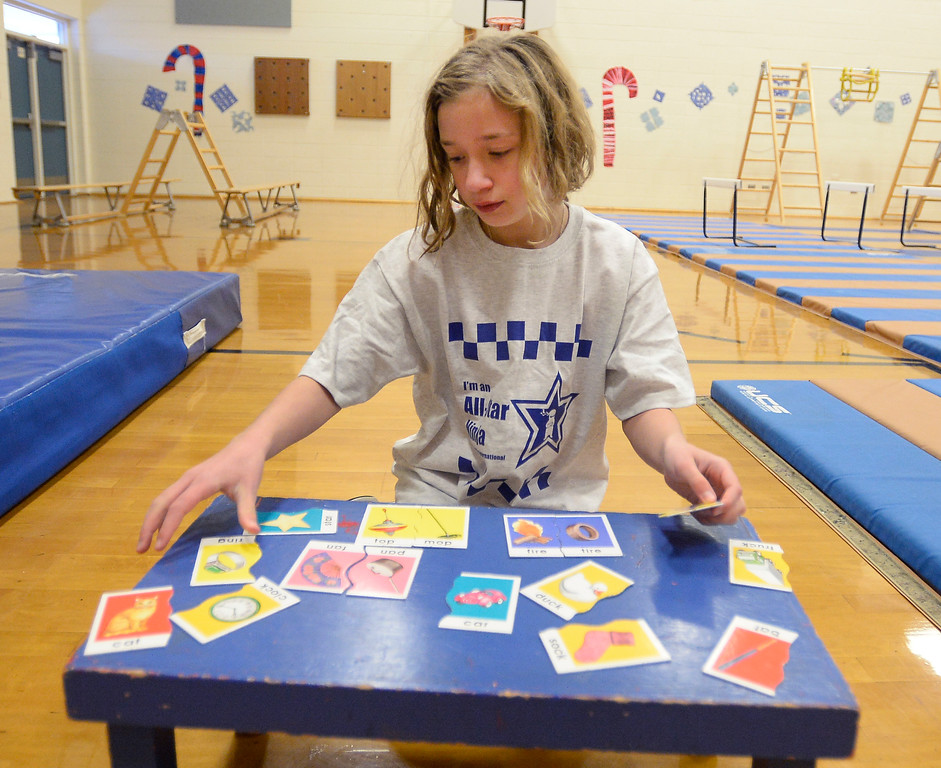 . LAFAYETTE, CO - January 31, 2019: Lana Straw, a 5th-grader, puts together a puzzle during the ninja learning course. Alicia Sanchez Elementary School in Lafayette is working to improve its test scores after getting placed on a turnaround plan based on the state\'s accreditation system. For more photos, go to dailycamera.com. (Photo by Cliff Grassmick/Staff Photographer)