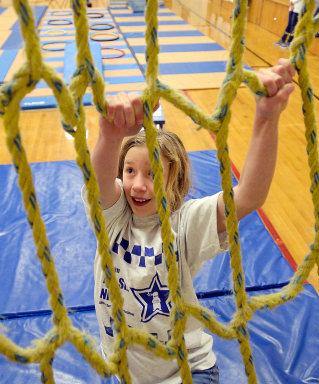 . LAFAYETTE, CO - January 31, 2019: Lana Straw, a 5th-grader, takes on the rope wall during the ninja learning course. Alicia Sanchez Elementary School in Lafayette is working to improve its test scores after getting placed on a turnaround plan based on the state\'s accreditation system. For more photos, go to dailycamera.com. (Photo by Cliff Grassmick/Staff Photographer)