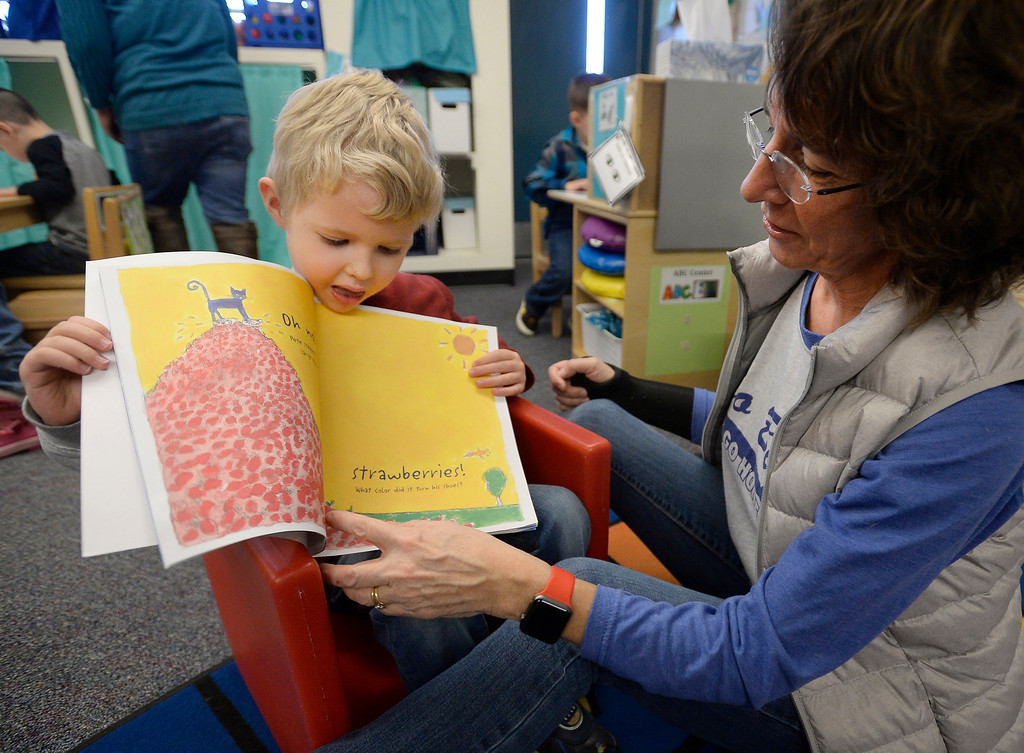 . LAFAYETTE, CO - January 31, 2019: Devereux Johnson, 3, reads a book with speech pathology teacher, Rosemary McKnight.  Alicia Sanchez Elementary School in Lafayette is working to improve its test scores after getting placed on a turnaround plan based on the state\'s accreditation system. For more photos, go to dailycamera.com. (Photo by Cliff Grassmick/Staff Photographer)