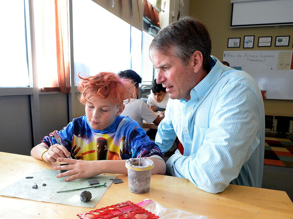 . LAFAYETTE, CO - January 31, 2019: Wyatt Carlisle talks about his art project with Principal Kent Cruger. Alicia Sanchez Elementary School in Lafayette is working to improve its test scores after getting placed on a turnaround plan based on the state\'s accreditation system. For more photos, go to dailycamera.com. (Photo by Cliff Grassmick/Staff Photographer)