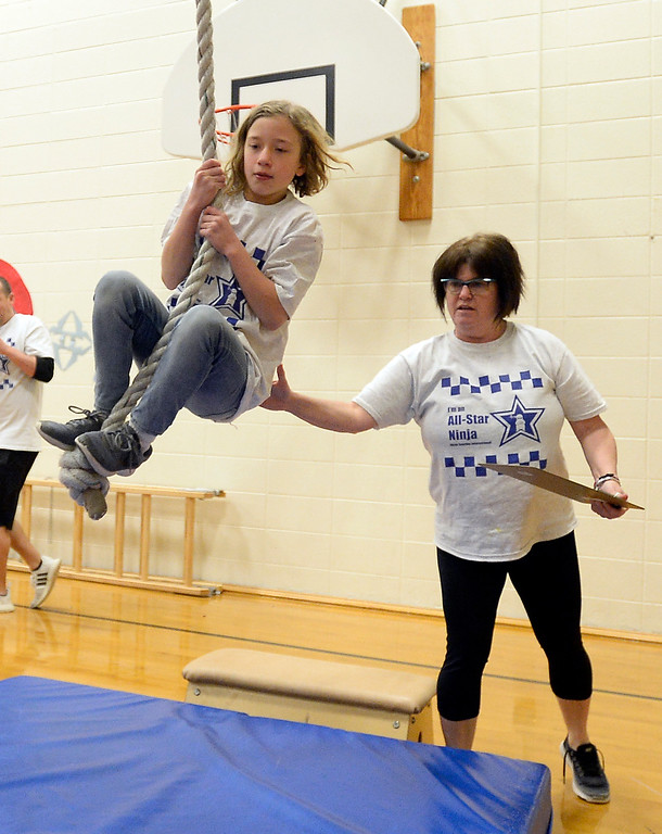 . LAFAYETTE, CO - January 31, 2019: Lana Straw, a 5th-grader, attacks the ninja learning course with help from teacher, Terry Mitchell. Alicia Sanchez Elementary School in Lafayette is working to improve its test scores after getting placed on a turnaround plan based on the state\'s accreditation system. For more photos, go to dailycamera.com. (Photo by Cliff Grassmick/Staff Photographer)