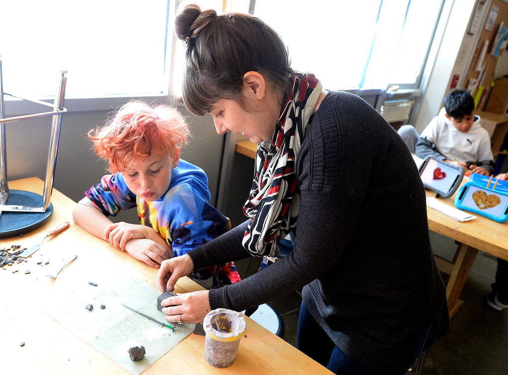 . LAFAYETTE, CO - January 31, 2019:  Wyatt Carlisle gets help with his art project from art teacher, Kat Potter. Alicia Sanchez Elementary School in Lafayette is working to improve its test scores after getting placed on a turnaround plan based on the state\'s accreditation system. For more photos, go to dailycamera.com. (Photo by Cliff Grassmick/Staff Photographer)