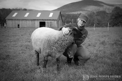 Megan Shackelford with a sheep at Woodstock Farm Animal Sanctuary