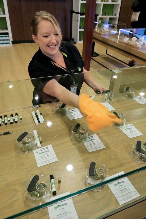 . Sanctuary Medicinals in Gardner has been open for medical sales since November 23, 2018. On Wednesday March 6, 2019 they opened for recreational sales. As they waited for a few more customers Liz Hinde a Patient Care Advisor cleaned the glass of the display case. SENTINEL & ENTERPRISE/JOHN LOVE