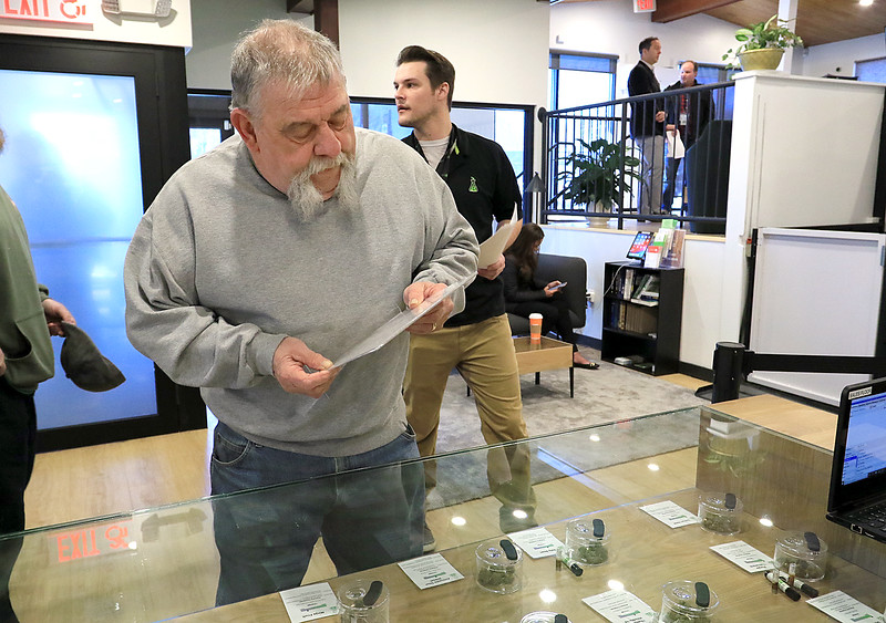 Sanctuary Medicinals in Gardner has been open for medical sales since November 23, 2018. On Wednesday March 6, 2019 they opened for recreational sales. Ken Walker of Fitchburg their first recreational customer tries to decide which strain of cannabis he wanted. SENTINEL & ENTERPRISE/JOHN LOVE